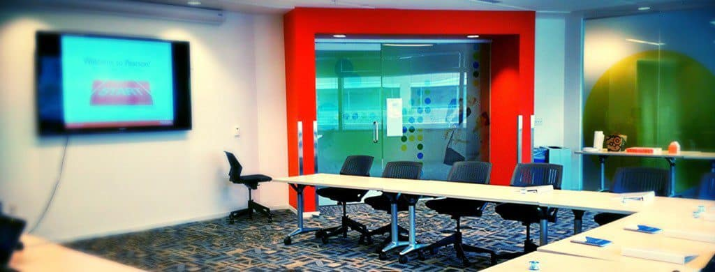 Brightly painted and cheerful conference room.