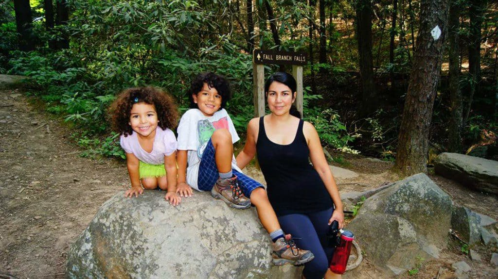 A mother and two children pose at a Trailhead
