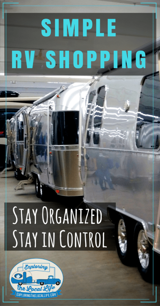 Airstream travel trailers on a showroom floor.