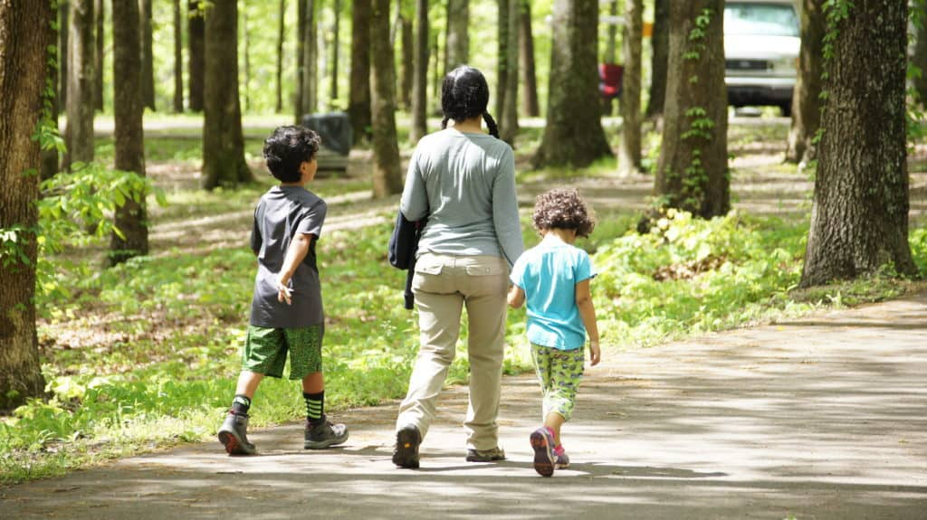 A mother and her children walk around the Meriwether Lewis Monument campground.
