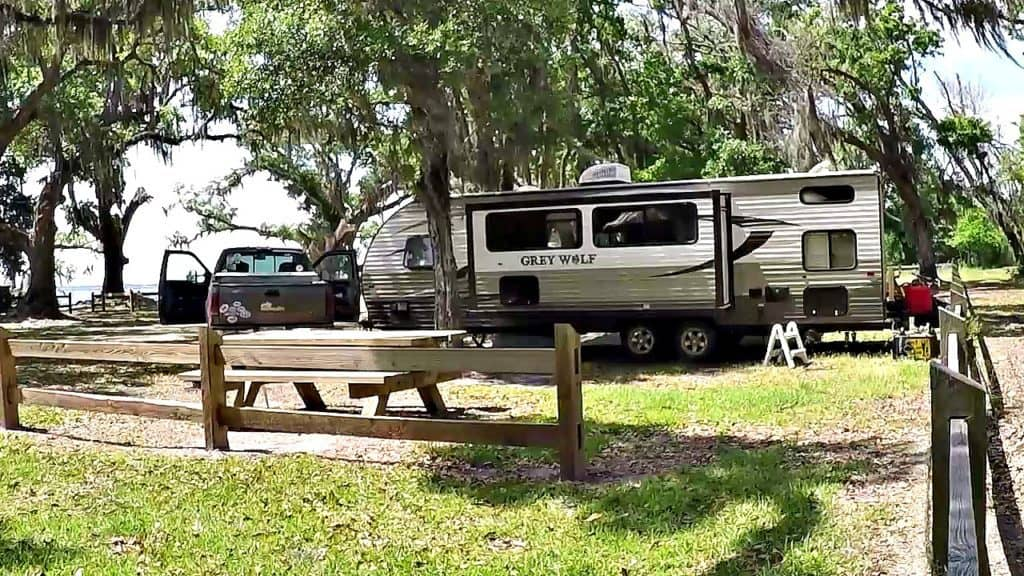 Truck and trailer parked in a campsite at Bayside Campground.
