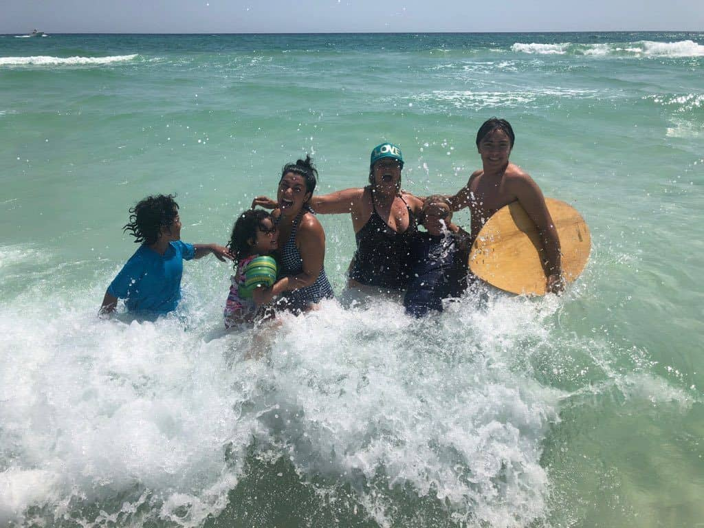 Two families enjoying the waves in the Gulf of Mexico on the Florida Panhandle.