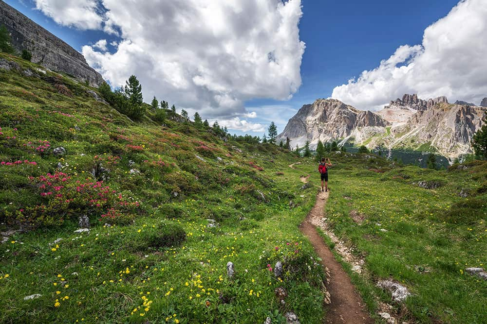 Hiker in the Rocky Mountain National Park in Colorado during spring.