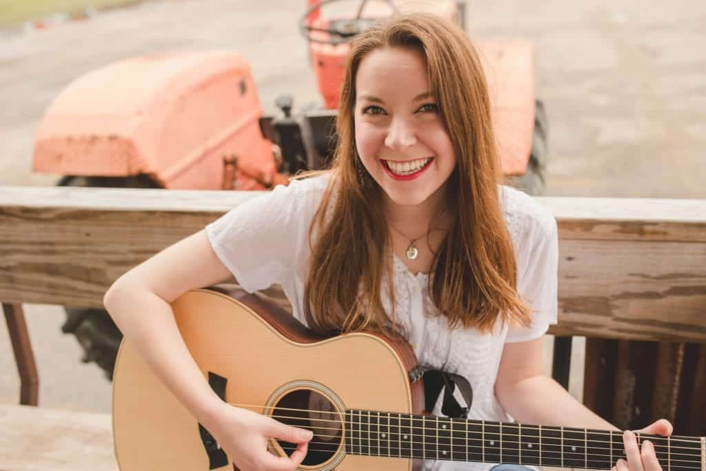 Kelsey Henry poses with her guitar