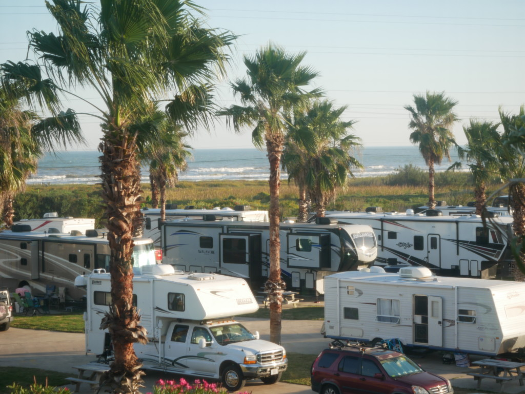 A photo of RVs parked at a beach front RV park.