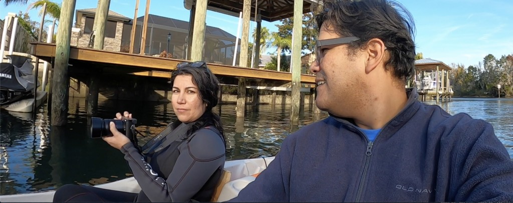 Male and female on the water in Crystal River after swimming with manatees. The female is wearing a wetsuit.